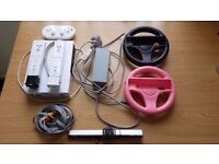 Nintendo Wii - With two Wii Remotes, sensor bar, controller, adapter, two steering wheels, and cable