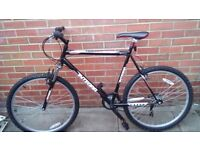 A 6 speed moutain bike in very good condition 26inch frame? Black.