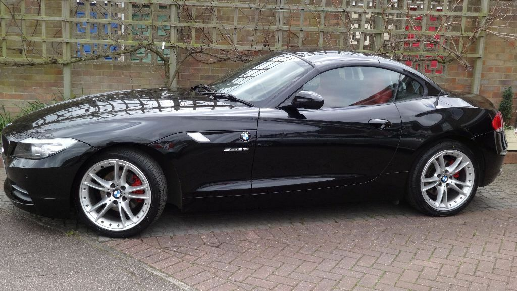 Bmw Z4 With Folding Metal Roof In Metallic Black With Red