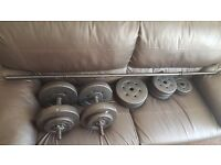 45kg of weights, 2 dumb bells and 1 bar bell
