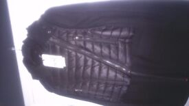 Ladies black brand new next coat 50% wool blend. Wool coat with light weight cropped removable gilet