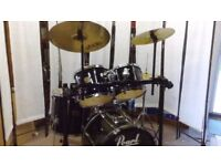 Retired drum teacher has a Pearl Export drum kit with cymbals & 3 sided rack for sale.