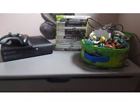 Xbox 360 with 11 games 2 skylanders portal's and 17 figures 2 controllers