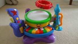 £8 Musical Toy with Instruments - Drum, Keyboard, Marcus, Tambourine, Guitar, Trumpet and Shaker