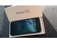 IPhone 5s boxed with charger wire