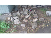 Old stones and bricks up for grabs - good for rock gardens etc