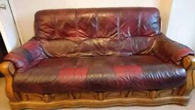 Leather 3 seater and two matching chairs.