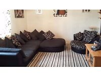 Large grey fabric and black leather sofa with big cuddle swivel chair