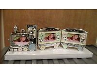 A BEAUTIFUL PINK AND SILVER TRAIN BABY PHOTO FRAME, HOLDS 3 PHOTO'S