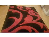 Almost new v modern stylish vv thick black thick pile rug with red 3d motif