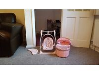 Baby anabelle two in one swing chair and high chair, along with carrier.