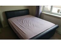 Leather Double bed in good condition with all bolts and parts