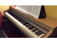 Roland digital piano Hp-2e and Matching stool, in excellent condition.