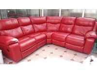 Large red leather corner sofa from Harveys Harrier Range. Manual recliner at each end.