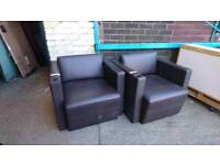 dark brown leather armchairs