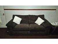 brown 3 seater sofa, arm chair and footstool