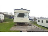 for sale cheap holiday home on a park with seaviews, pets welcome, 11 month season,park investment