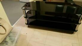 Black and chrome 3 tier t.v stand
