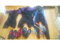 Selection of teenage/adult wetsuits and water shoes