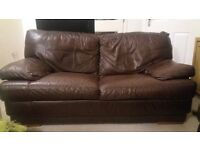 2x large 2 seater leather sofas,some signs of wear,from smoke and pet free home