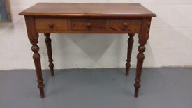 Antique pine side table, with 3 drawers. Pitch pine. Deep red/brown colour.