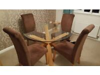 Glass circular dining table and 4 chairs