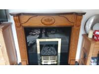 Fireplace surround in wood with granite hearth/back