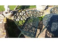 Cast iron antique chairs and table.