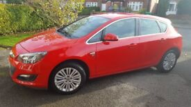 Absolutely fantastic condition. June 2014. Flame red,Vauxhall Astra 1.4 Excite.