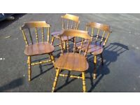 Set of four stained pine dining chairs