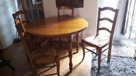 S9oloid wood table and chairs