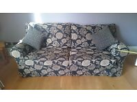 Patterned sofa and snuggle chair