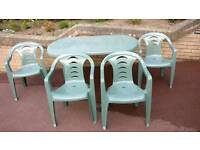 Green plastic table and 4 chairs