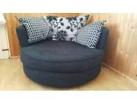 DFS swivel love seat round sofa