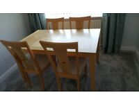 Dinning table and chairs with matching nest of tables.
