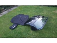 Toyota MR2 hardtop roof in black with storage bag and fixing kit.