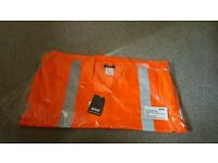 Orange florescent Jacket size large - new in packet