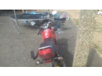 Hond cbr125r and top box with helmeit