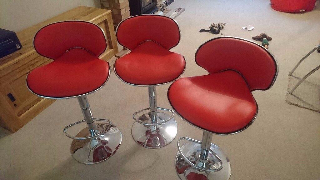 Red gas adjustable bar stools
