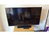 Like new 50 inch hd tv with box, packaging, and all materials