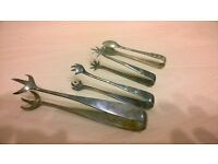4 old sugar and Ice tongs. all stamped