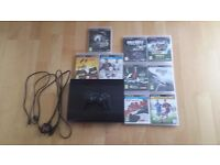 PS3 console and 9 games vgc