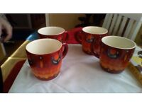 poole pottery volcano mugs