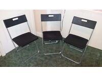 3 black IKEA folding chairs