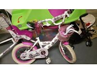 Girls bike with stabilisers, front basket, tussles and doll seat