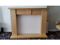 "a robust fire surround totally fire proof light oak in colour size 40"" h*49""w app. comes in 4 parts"