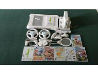 Wii bundle including Wii fit board, charging docking station, games and accessories.