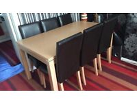 Oak dinning table and 6 Faux leather chairs.