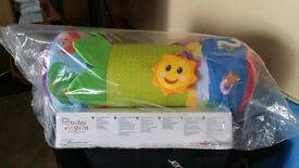 Baby Einstein, rhythm of the reef prop pillow. Encourages tummy time play