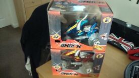 2 remote control cars as pictured new and boxed